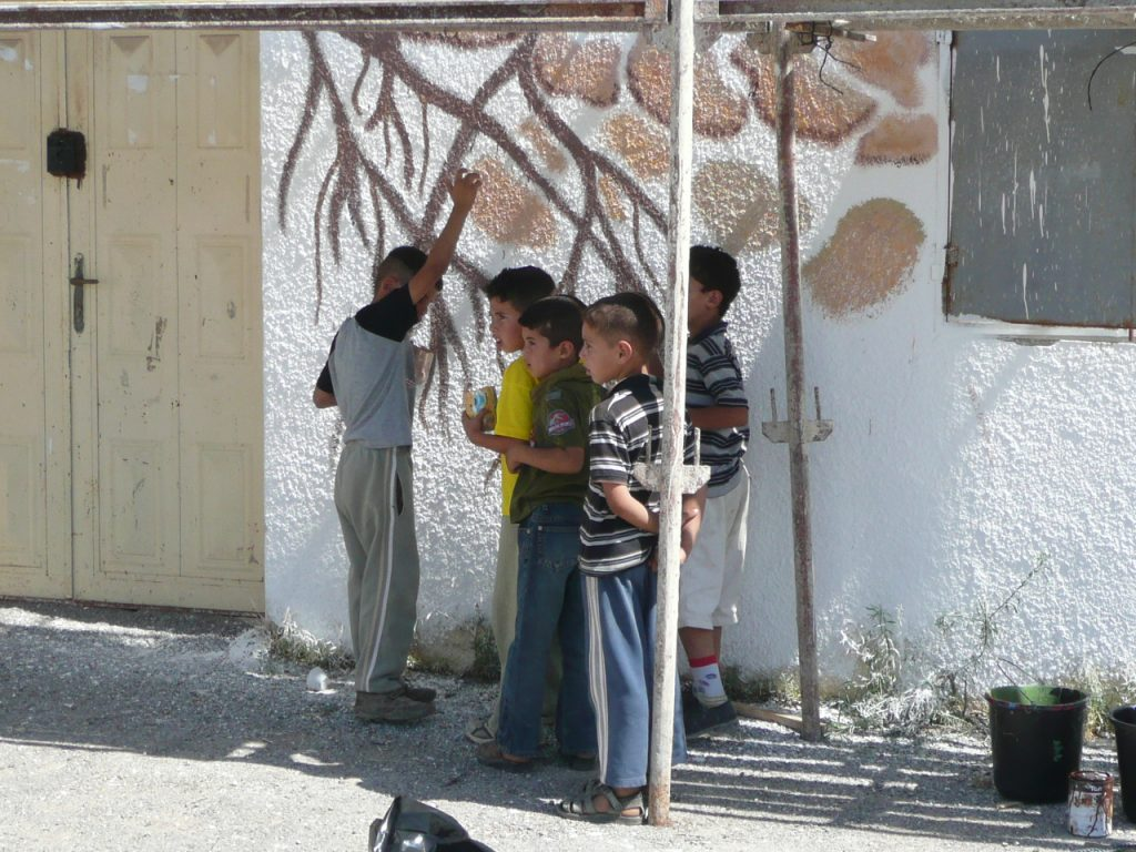 Youth from the neighborhood came out to watch our progress and to help paint.